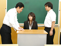 Sexy and arousing dark haired teacher Maho Sawai with glasses gets her black suit taken off and her hairy natural slit rammed pretty hard by a group of her turned on students after the class is over in a nasty group sex session on the desk and moansvideo